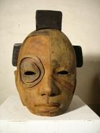 Nuba, bronce y madera, 20x25x24cm.