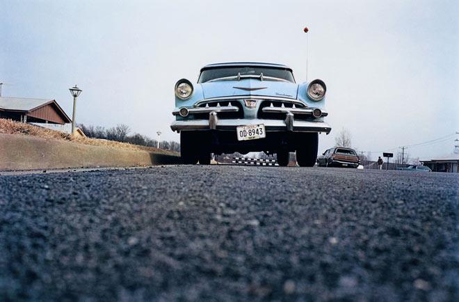 William Eggleston, Untitled -Blue Car on Suburban Street-, Memphis, TN, 1970