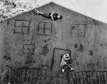 Abelardo Morell , Laura and Brady in the Shadow of Our House, 1994
