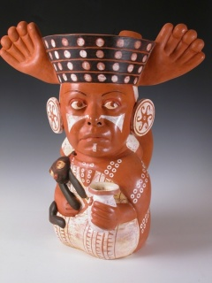 Kukuli Velarde, Chola de Mierda, 2006, Terracotta with engobes and wax, 20 x 17 x 17 inches, collection of the Artist, photograph courtesy of Doug Herren