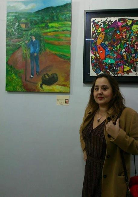 Pintora Silvia G.Armesto junto con su obra