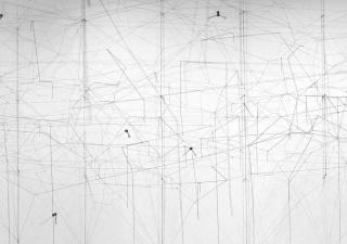 Image: Gustavo Pérez Monzón, SOSTENIDO, 2017. Site specific installation, elastic thread, lead. Dimensions variable. Photo by Issac Martínez. © The Artist; Courtesy Richard Saltoun Gallery, London