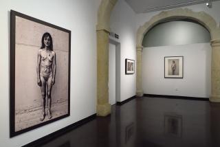 """Sala planta baja del CAF. Exposición """"Prostitución. Retratos de una vida en la calle"""", de Rubén García."""