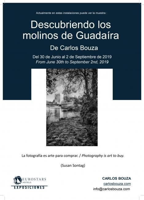 """Cartel de la exposición """"Descubriendo los molinos del Guadaíra"""" en Eurostars Central de Madrid"""