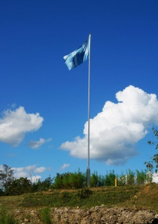 Byron Kim, Sky Blue Flag, 2018. Indigo dyed ramie, flag pole. Entrance of Soi Mountain, Cheorwon, Gangwondo. Commissioned by the Real DMZ Project.