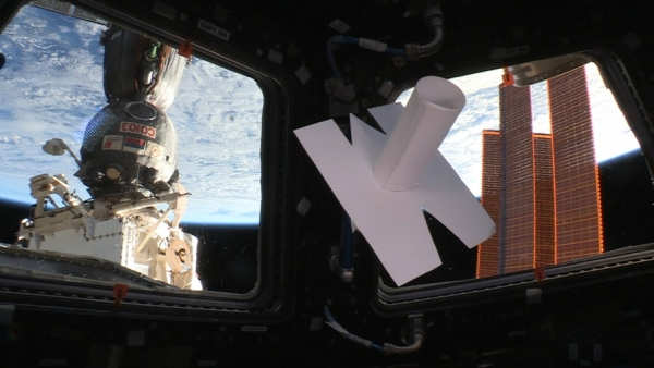Inner Telescope floating in the International Space Station (ISS), in orbit around the Earth