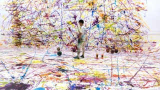 Kyungah Ham, Soccer Painting by the Soccer Ball Bouncing Over Crocodile Rive, film still, 2016 color, sound, soccer balls, video installation, performance, North Korea defector soccer player, acrylic paint, soccer balls, soccer paintings, soccer shoes, te
