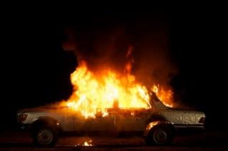 Superflex. Burning Car.