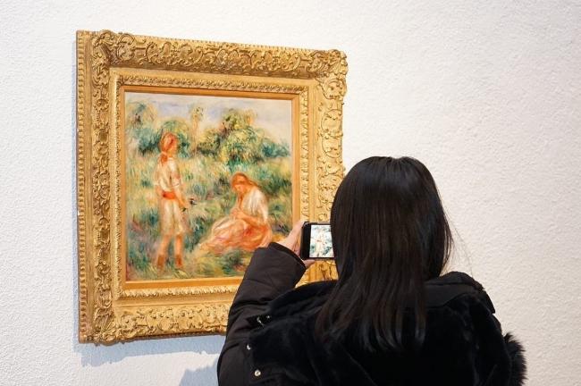 Auguste Renoir. Femme et jeune fille dans un paysage c.1916