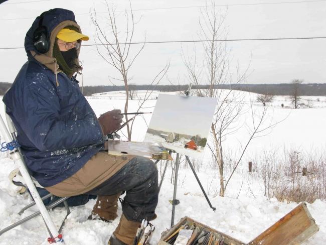 En la fotografía, Félix de la Concha pintando los paisajes nevados de Iowa — Cortesía de la Galería Siboney