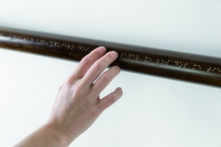 David Escalona, Puntos de apoyo (Supporting Points), 2015. Three wooden bars with alloy braille inscription