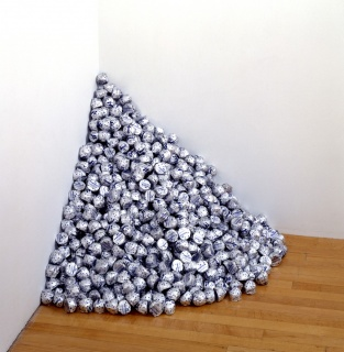 "Felix Gonzalez-Torres, ""Untitled"" (A Corner of Baci), 1990, endless supply of Baci chocolates individually wrapped in silver foil, ideal weight: 42 lbs., dimensions variable. The Museum of Contemporary Art, Los Angeles, purchased with funds provided by th"