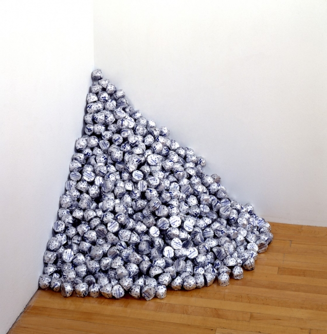 """Felix Gonzalez-Torres, """"Untitled"""" (A Corner of Baci), 1990, endless supply of Baci chocolates individually wrapped in silver foil, ideal weight: 42 lbs., dimensions variable. The Museum of Contemporary Art, Los Angeles, purchased with funds provided by th"""