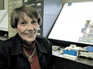 Jackie Barnitz in her slide collection. Photo: Mike Wellen. Courtesy of Benson Latin American Collection